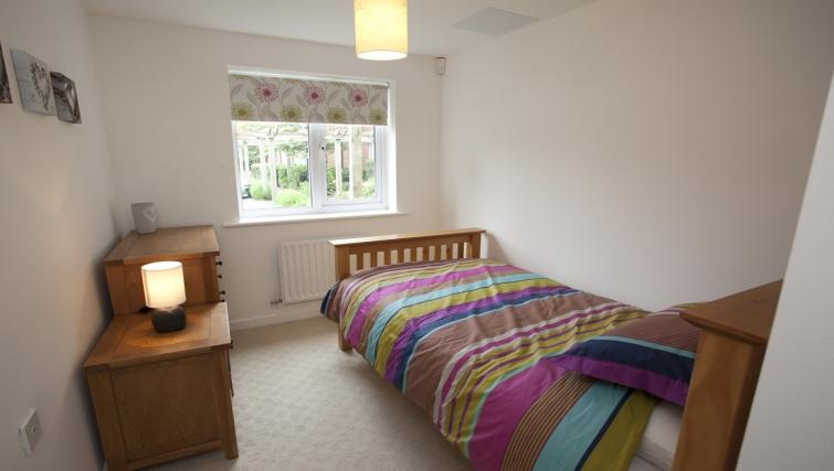 Bed at Cricket Heaven Apartment - Citybase Apartments