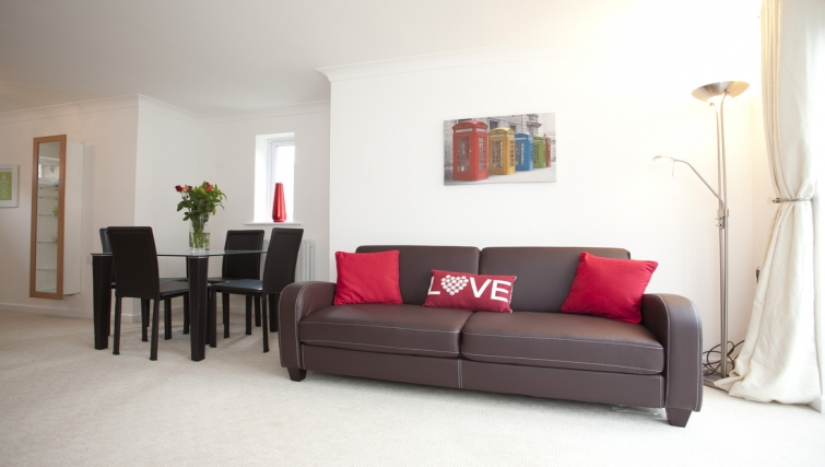 Open-plan living area at Cricket Heaven - Citybase Apartments
