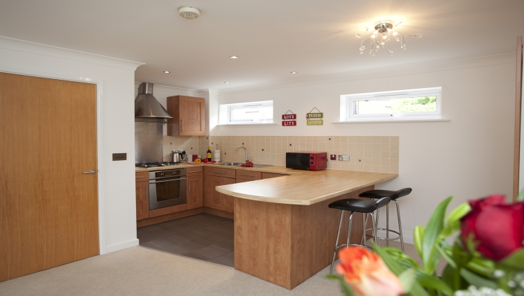 Equipped kitchen at Cricket Heaven Apartment - Citybase Apartments