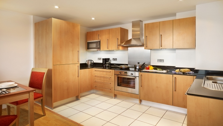 Stately kitchen at Empire Square Apartments - Citybase Apartments
