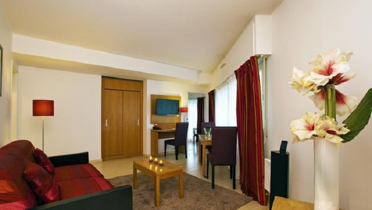 Living area in Residhome Parc du Millenaire Apartments - Citybase Apartments