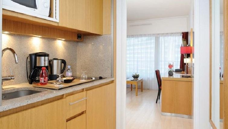 Kitchen in Residhome Parc du Millenaire Apartments - Citybase Apartments