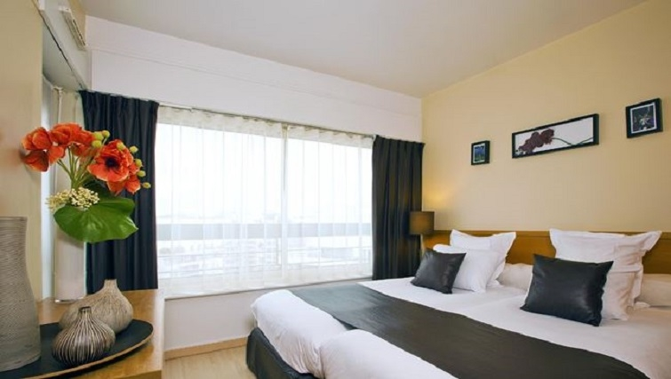 Comfy bedroom in Residhome Parc du Millenaire Apartments - Citybase Apartments