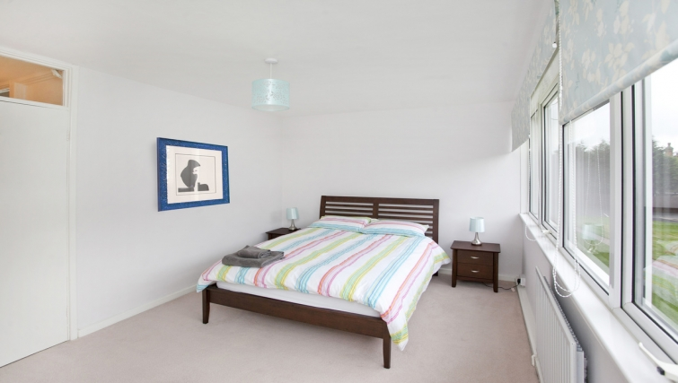 Bright bedroom at Cafe Culture Apartments - Citybase Apartments