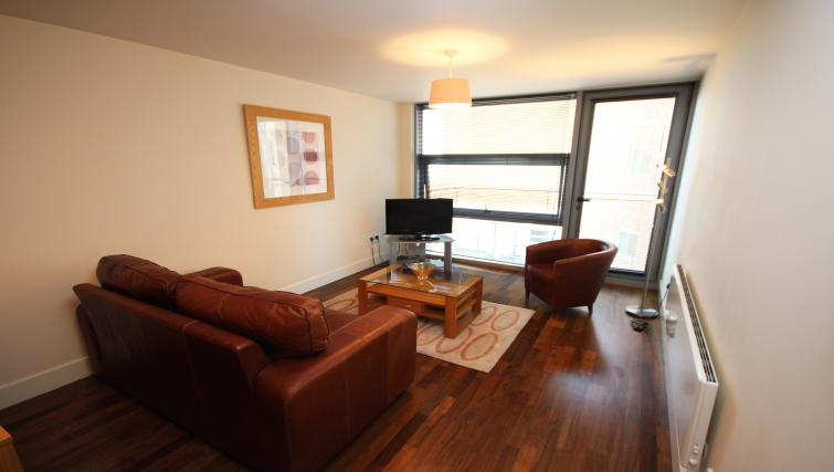Living room at Lime Square Apartments - Citybase Apartments