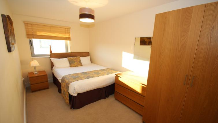 Comfy bedroom at Lime Square Apartments - Citybase Apartments