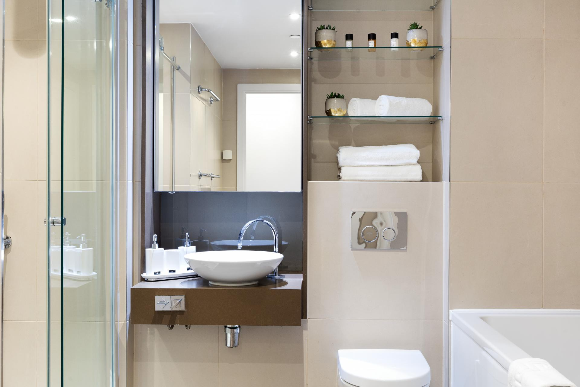 Bathroom mirror and storage at Lexicon Book House Apartments - Citybase Apartments