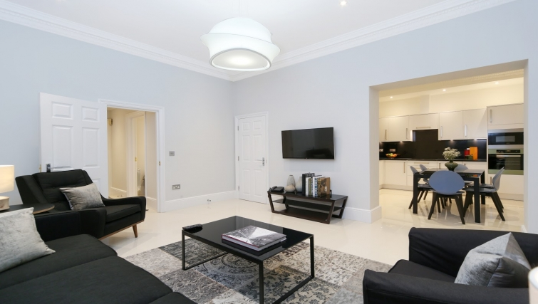 Open-plan living area at Queensgate Court Apartments - Citybase Apartments