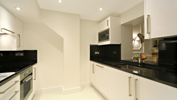 Kitchen in a Studio at Queensgate Court Apartments - Citybase Apartments