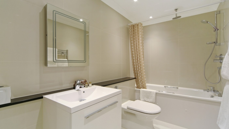 Bathroom at Queensgate Court Apartments - Citybase Apartments