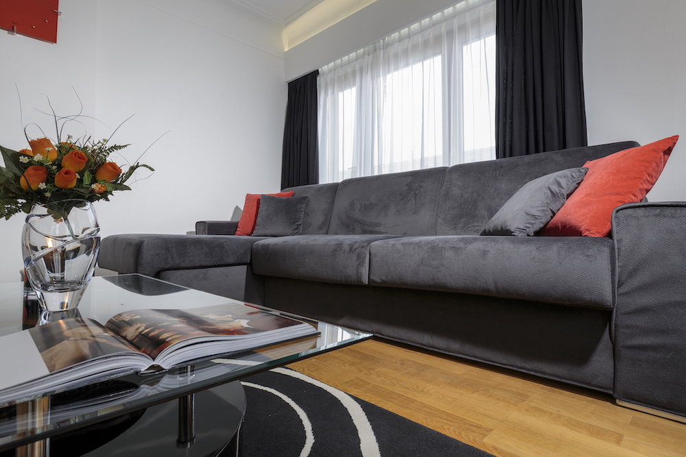 Sofa at Villa Carlotta Apartments - Citybase Apartments