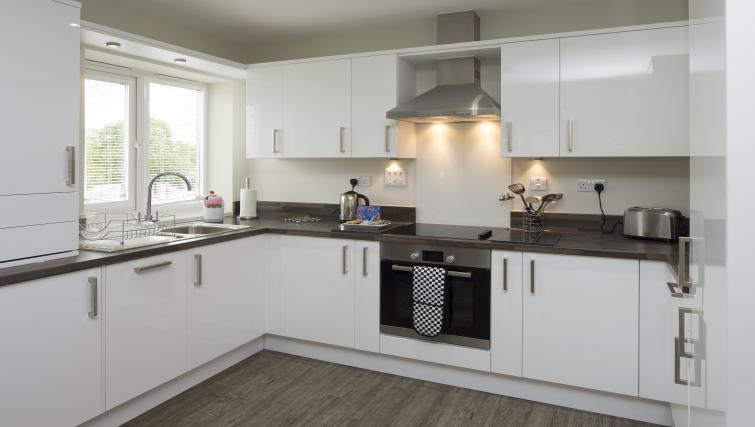 Kitchen at Beneficial House Apartments - Citybase Apartments