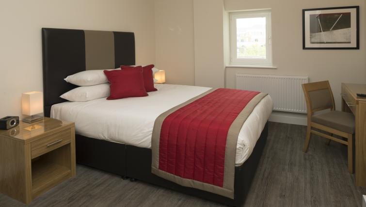 Bed at Beneficial House Apartments - Citybase Apartments