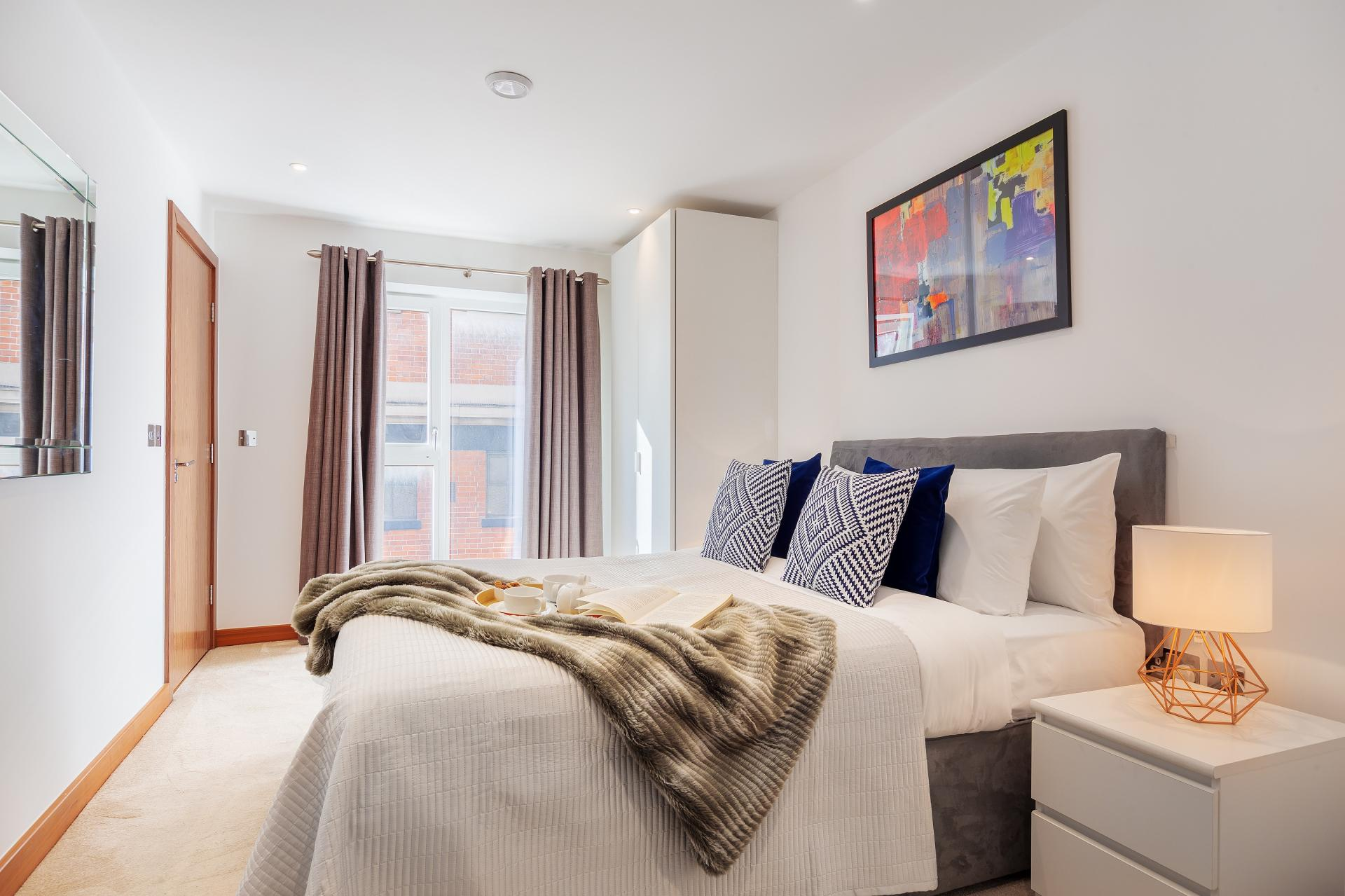 Modern bedroom at Shoreditch Square Apartments - Citybase Apartments