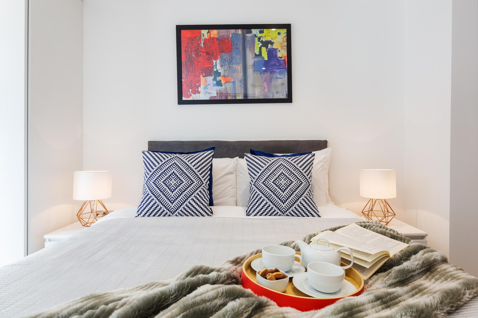 Cosy bedroom at Shoreditch Square Apartments - Citybase Apartments