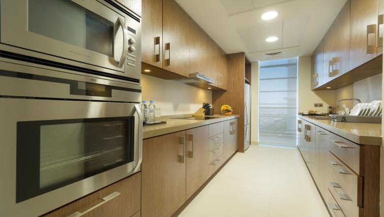 Kitchen at Adagio Abu Dhabi Al Bustan - Citybase Apartments