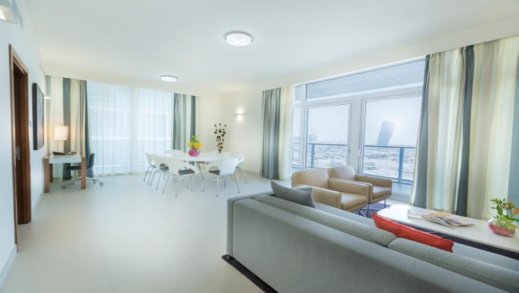Modern living area at Adagio Abu Dhabi Al Bustan - Citybase Apartments