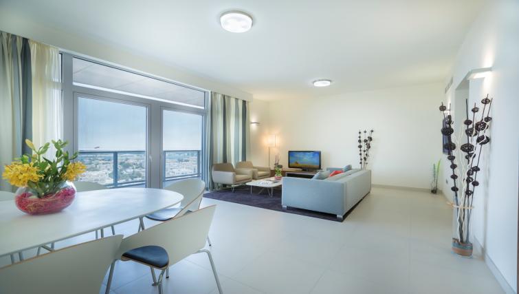 Living area at Adagio Abu Dhabi Al Bustan - Citybase Apartments