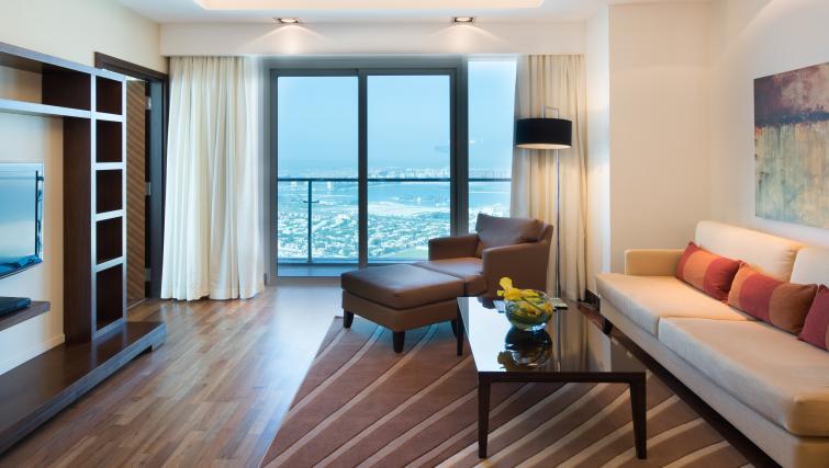 Stylish living area at Fraser Suites Dubai - Citybase Apartments