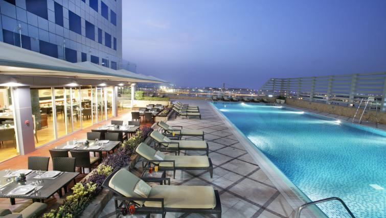 Swimming pool at Fraser Suites Dubai - Citybase Apartments