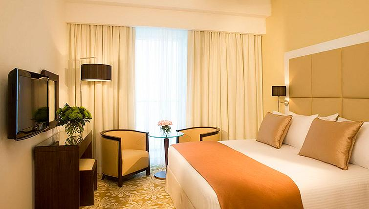 Comfortable bedroom at Fraser Suites Dubai - Citybase Apartments
