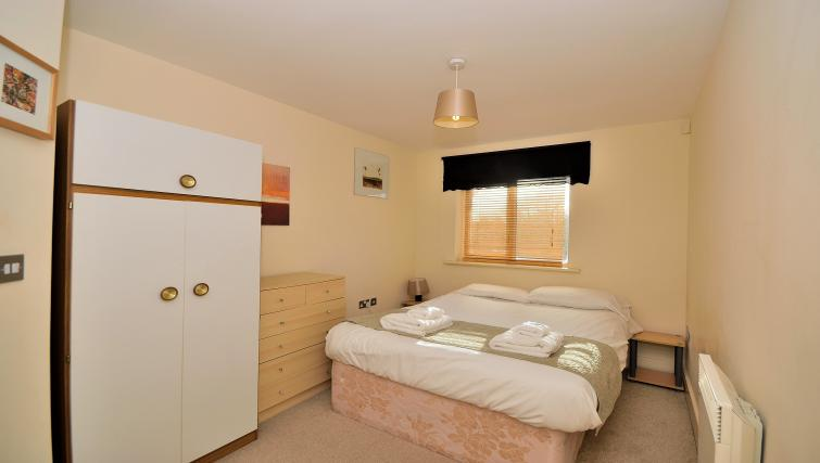 Comfortable bedroom at The Wharf Apartment - Citybase Apartments
