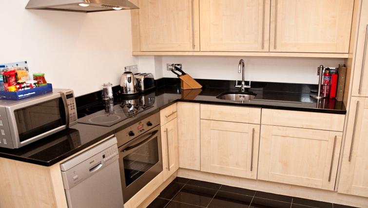 Contemporary kitchen at Clarendon 140 Minories - Citybase Apartments