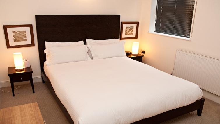 Elegant bedroom at Clarendon 140 Minories - Citybase Apartments