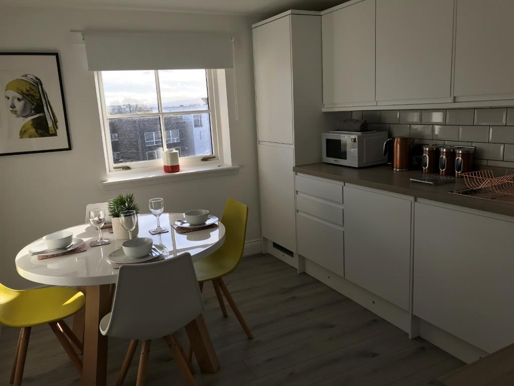 Dining area at St Andrew Square Apartments - Citybase Apartments
