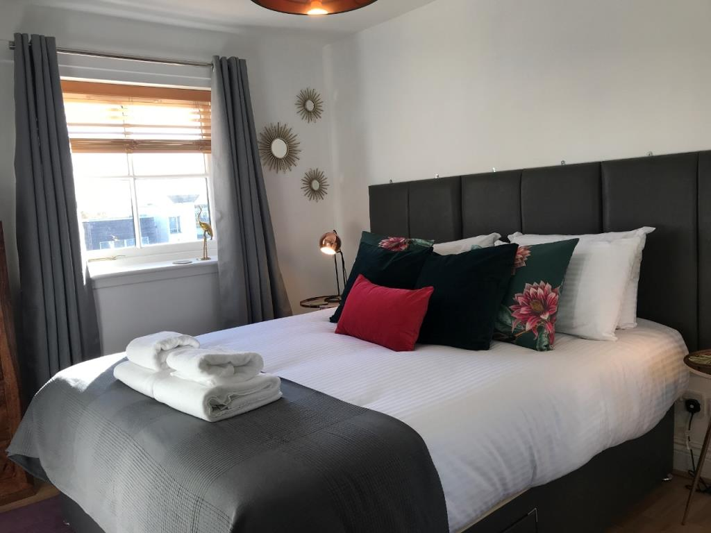 Bright bedroom at St Andrew Square Apartments - Citybase Apartments