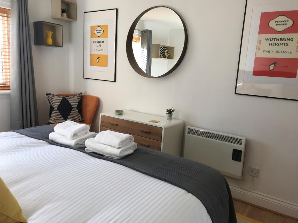 Modern bedroom at St Andrew Square Apartments - Citybase Apartments
