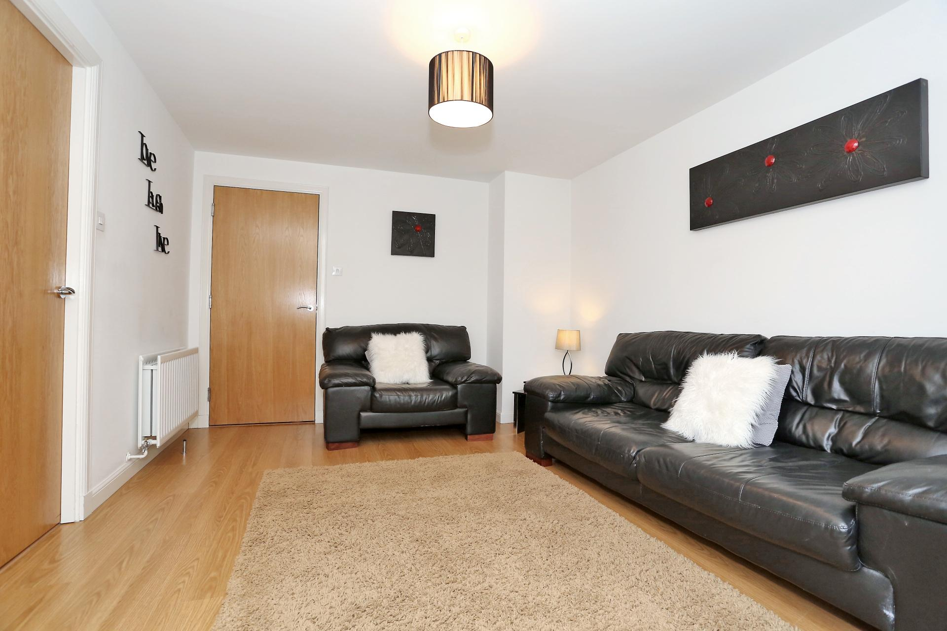 Spacious living area at The Dee Village Apartment - Citybase Apartments