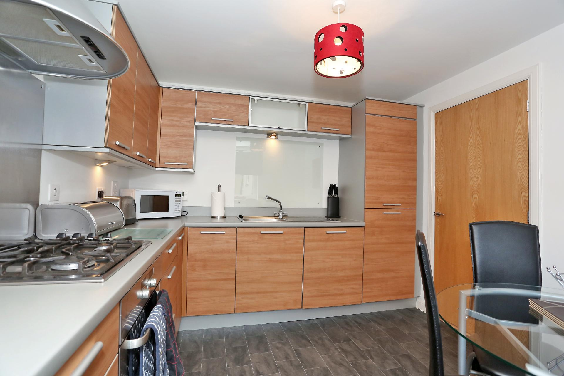 Kitchen at The Dee Village Apartment - Citybase Apartments