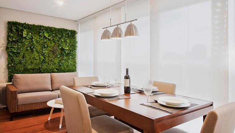 Dining area at DNA Pinheiros by Q Apartments - Citybase Apartments