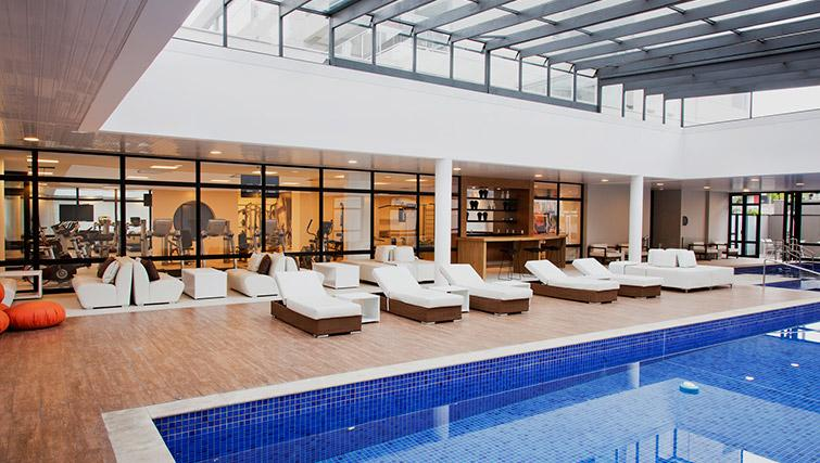 Indoor pool at DNA Pinheiros by Q Apartments - Citybase Apartments