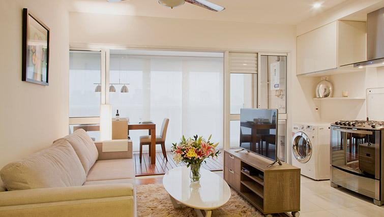 Living room at DNA Pinheiros by Q Apartments - Citybase Apartments
