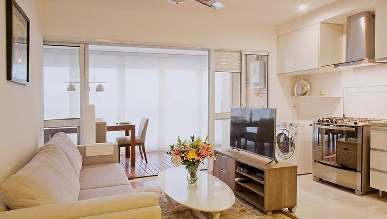 Open plan living area at DNA Pinheiros by Q Apartments - Citybase Apartments