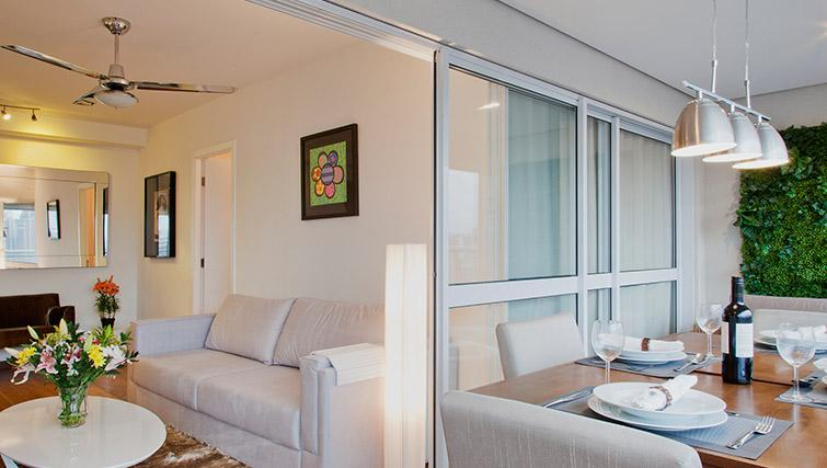 Living/dining area at DNA Pinheiros by Q Apartments - Citybase Apartments