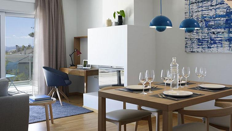 Dining table at Scale Suites Luxury Residence - Citybase Apartments