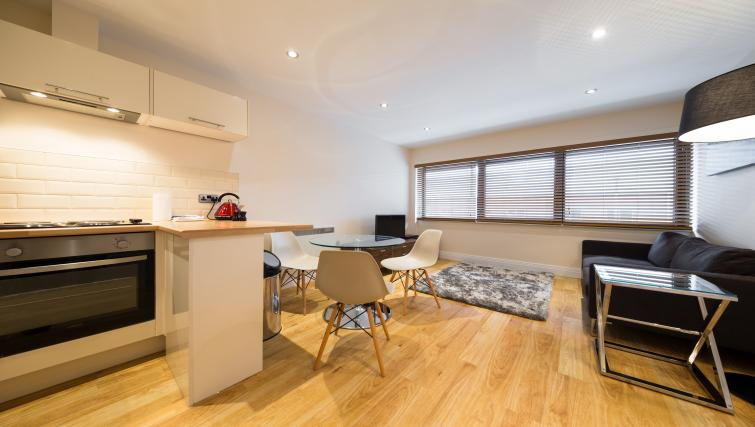 Living/dining area at Morris Suites - Citybase Apartments