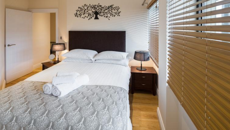 Bed at Morris Suites - Citybase Apartments