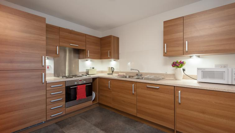 Equipped kitchen at Argyle Tower Apartments - Citybase Apartments