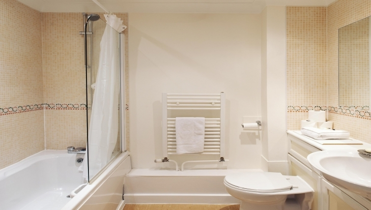 Neat bathroom with a bath at Market Rise Apartments - Citybase Apartments