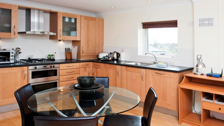 Contemporary kitchen & dining area at Market Rise Apartments - Citybase Apartments