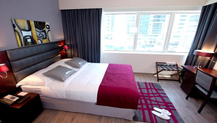 Bright bedroom at Links Hotel Apartments - Citybase Apartments