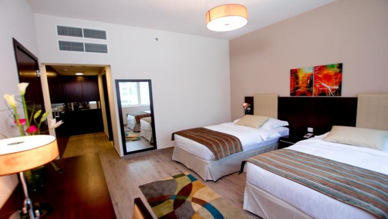 Bedroom and twin beds at Links Hotel Apartments - Citybase Apartments