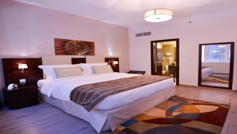 comfy bedroom atLinks Hotel Apartments - Citybase Apartments