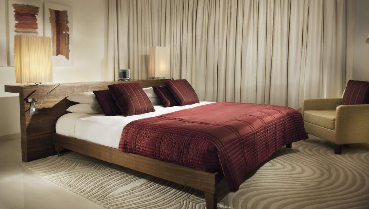 Bedroom at Fraser Suites Doha - Citybase Apartments