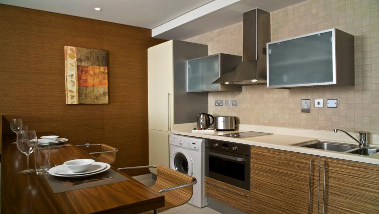 Kitchen in studio deluxe at Fraser Suites Doha - Citybase Apartments