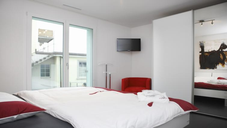 Double bedroom at Bahnhofstrasse Apartments - Citybase Apartments